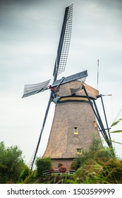 View of traditional Dutch Windmill and landscape seen from Kinderdijk Netherlands