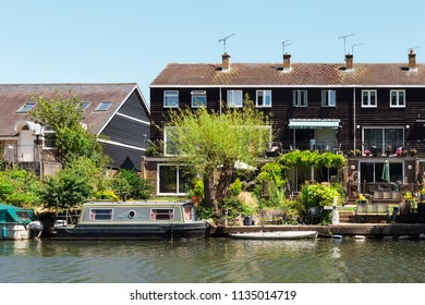 A view of traditional English waterfront buildings with boats