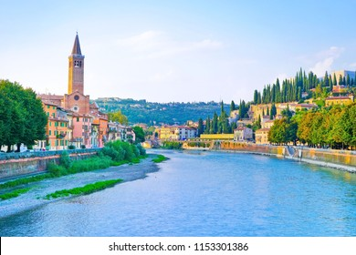 View of the traditional Italian houses along Adige river at sunset in Verona, Italy.