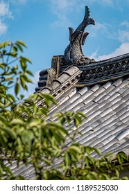 View of Traditional Japanese Slanted Rooftop with Shachihoko Gargoyle. Summer Day, Portrait Orientation, Close Up (Matsumoto, Japan).