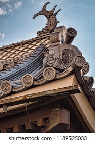 View of Traditional Japanese Slanted Rooftop with Shachihoko Figurine. Summer Day, No People (Matsumoto, Japan).
