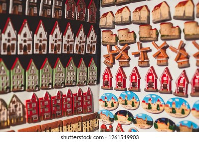 View of traditional souvenirs from Tallinn with fridge magnets and and old town small house toys miniature in local vendor souvenir shop of Old Town, Estonia