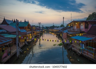 View of Traditional Thai style house and store on both side of the canal while the sun setting at Samut Songkhram province,Thailand.December-2015.