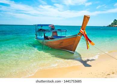 View of traditional thailand longtail boat at sand beach of tropical island in Andaman sea