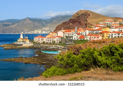 View of traditional village houses and port on east coast of Madeira island, Portugal