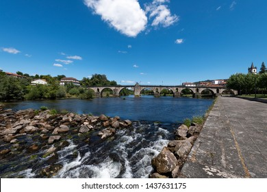 View of the traditional village of Ponte da Barca in the Minho Region of Portugal, with the Lima River and the old bridge.