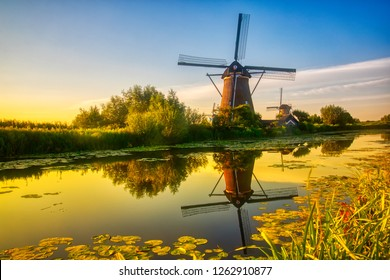 View of traditional windmills at sunset in Kinderdijk, The Netherlands.