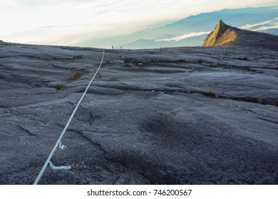 View of trail and mountain rope on the top of majestic Mountain Kinabalu in Sabah Borneo.Its the highest mountain in Malaysia is one of Borneo's most popular tourist attractions & climbers.