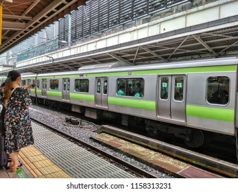 View to the Train Station with coming Trains of Tokyo in Japan 2018.