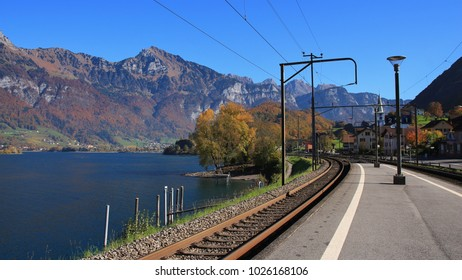 View from the train station in Mols, St Gallen canton, Switzerland. Autumn day at lake Walensee. Mountain of the Churfirsten range.