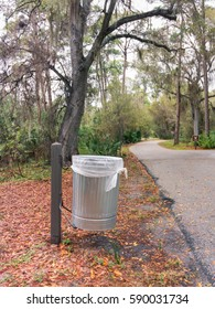 The view of trash can by a path in a park