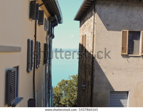 View of Trasimeno Lake from the small medieval village of Monte del Lago in Umbria, Italy.