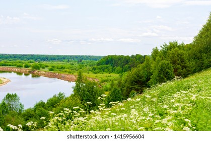 View of the traveler from the shore to the river in Vetluga. Kostroma region. Russia. The concept of tourism, Summer holidays with the whole family.