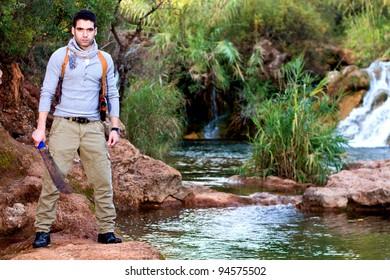 View of an treasure hunter, jungle adventurer type man.