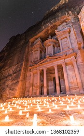 View of the Treasury during Petra By Night in Jordan under the starry sky