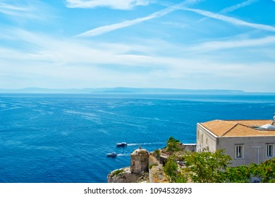 view of Tremiti islands with blue water, boats and clouds. Gargano. Puglia, Italy. for nature, travel and holyday concepts