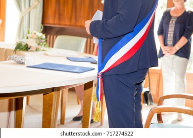 view of the tricolor scarf of the mayor during a celebration in France