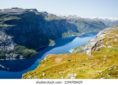 View from the Trolltunga trail. Mountain lake Ringedalsvatnet. Norwegian landscape in sunny weather