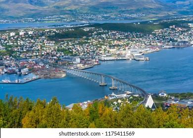 View of Tromso on island of Tromsoya linked across Tromsoysundet strait with Tromsdalen on mainland by a Tromso Bridge. Norway