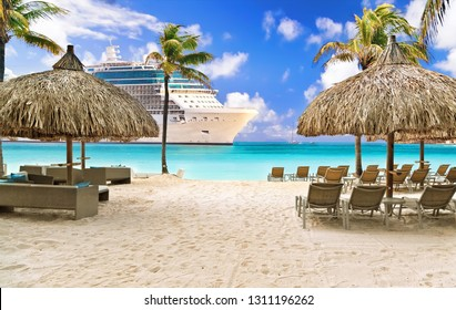 View from tropical beach on cruise ship sailing to port