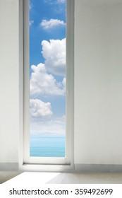 View of tropical beach through windows
