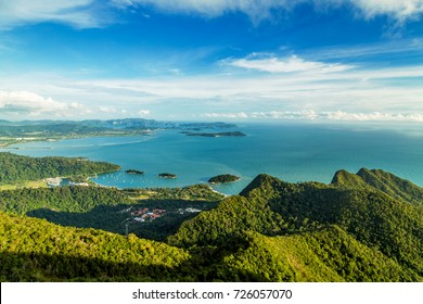 View of tropical island Langkawi in Malaysia, covered with tropical forests. Aerial view on the bay, marina and archipelago of smaller islands in Andaman sea.