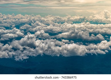 View trough airplane window. Amazing earth. Perks of traveling life. Speechless moment. Clouds all around. Feels like heaven. Mother nature gift. Enjoy your life. Adventure.