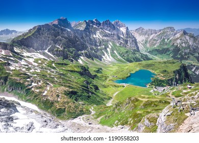 View of Truebsee and Swiss Alps from Titlis mountain. Truebsee is an Alpine lake in the Swiss canton of Nidwalden, Switzerland, Europe.