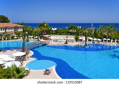 a view of a Turkey resort place  in Antalya with nice pool near a Mediterranean costline