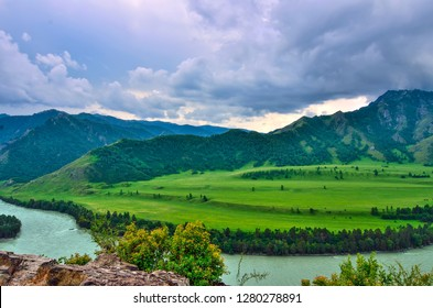 View of turquoise mountain river Katun flowing in valley near Che-Chkysh - beautiful summer landscape at cloudy weather, Altai mountains, Russia