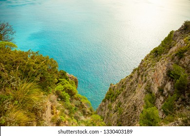 View of turquoise sea water in ravine from Mountain road with sea view near Maratea, Basilicata in Italy