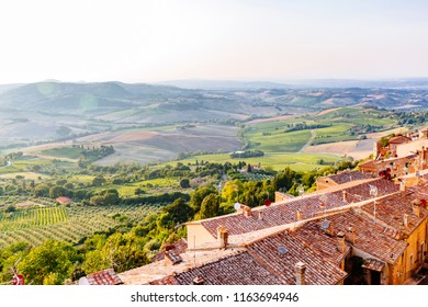 View of Tuscan Houses and Hills at Dusk near Montepulciano, Italy