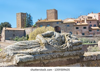 View of Tuscania with Etruscan statue - Viterbo Italy