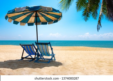 View of two chairs and parasols on the beach, sky Summer vacation concept Consists of travel websites