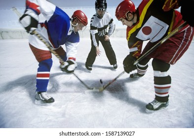 View of two ice hockey players going for the puck