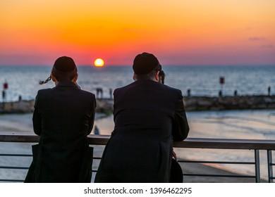 View of two Jewish men on promenade at sunset, Hayarkon Street, Tel Aviv, Israel, Middle East 2-3-2019