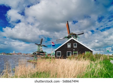 view of two traditional Dutch windmills of Zaanse Schans, Netherlands