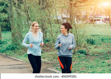 View of two women running together in the park