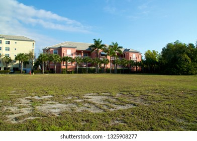 View of typical generic apartment buildings or condos in sub tropical Bonita Springs florida on a sunny winter morning.