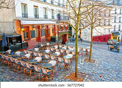 View of typical paris cafe in the artists' quarter Montmartre in Paris at morning, France