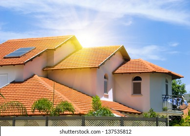 A view of typical vintage house with tile roof