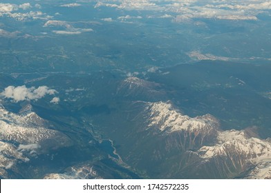 View of Ulten-Ultimo Valley and city of Bolzano in background from an airliner porthole. Concept: air travel, aerial panoramas.