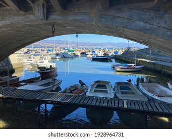 view under the bridge,  the boats