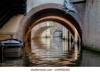 A view under the bridges with reflection under a canal in 's-Hertogenbosch (Den Bosch), Netherlands.