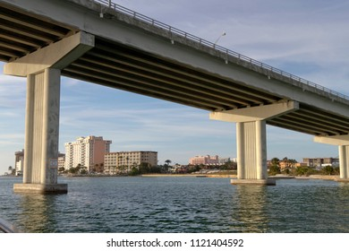 View from under Clearwater Pass Bridge in Clearwater, Florida around sunset. The bridge is an award-winning construction with twenty one spans of 120 feet each and a 74′ vertical clearance