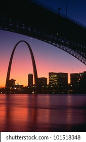 View from under the Eads Bridge of St. Louis Missouri skyline and archway at night