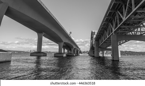 A view from under the I-90 bridge in Seattle, Washington. Black and white image.