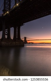 View from under the manhattan bridge at sunset with long exposure