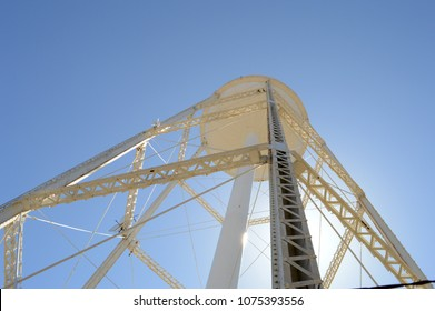 A view from underneath a tall metal water tower.