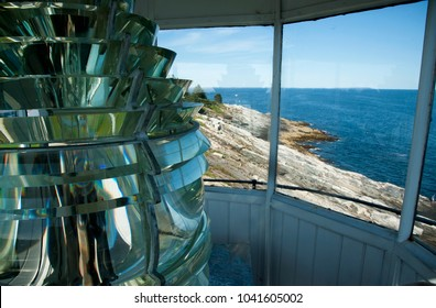 View of unique rock formations on the coast from the top of Pemequid Point lighthouse tower with authentic fresnel lens. This would be the same view from the early keepers of the beacon with this lens